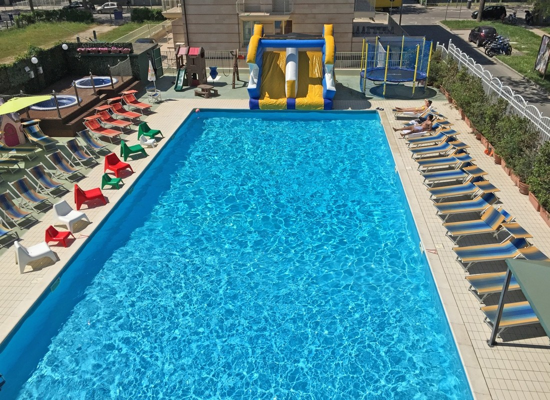Home U003e The Hotel Swimming Pool With Inflatable Slide